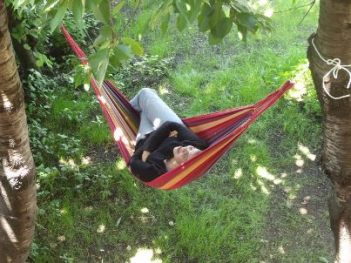 Student of Spanish course relaxing in hammock